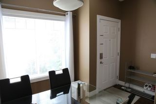 Photo 5: 84 BRIDLERIDGE Manor SW in Calgary: Bridlewood Row/Townhouse for sale : MLS®# A1029938