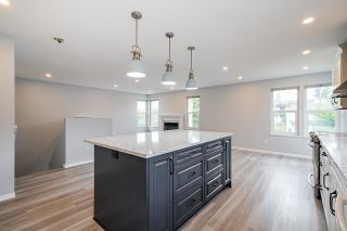 """Photo 7: 6632 197 Street in Langley: Willoughby Heights House for sale in """"Langley Meadows"""" : MLS®# R2622410"""