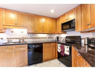 """Photo 11: 844 W 7TH AVE - LISTED BY SUTTON CENTRE REALTY in Vancouver: Fairview VW Townhouse for sale in """"WILLOW CASTLE"""" (Vancouver West)  : MLS®# V1106691"""