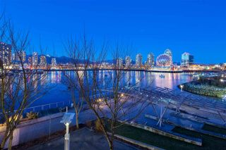 "Main Photo: 303 151 ATHLETES Way in Vancouver: False Creek Condo for sale in ""Canada House"" (Vancouver West)  : MLS®# R2367570"