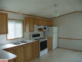 """Photo 2: 169 1840 160TH Street in Surrey: King George Corridor Manufactured Home for sale in """"Breakaway Bays"""" (South Surrey White Rock)  : MLS®# F1118468"""