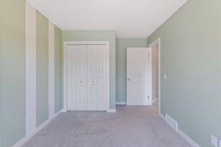 Photo 34: 144 Heritage Boulevard: Cochrane Detached for sale : MLS®# A1125296