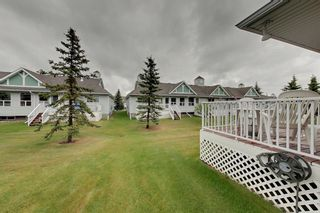 Photo 4: 38 1008 Woodside Way NW: Airdrie Row/Townhouse for sale : MLS®# A1123458