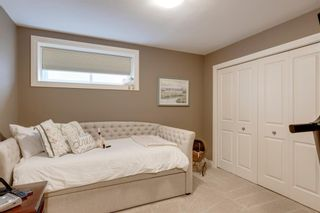 Photo 17: 198 Cougar Plateau Way SW in Calgary: Cougar Ridge Detached for sale : MLS®# A1133331