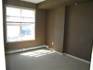 Photo 7: 2-615 4245 139 Avenue in Edmonton: Zone 35 Condo for sale : MLS®# E4266318