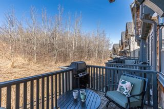 Photo 4: 440 Ascot Circle SW in Calgary: Aspen Woods Row/Townhouse for sale : MLS®# A1090678