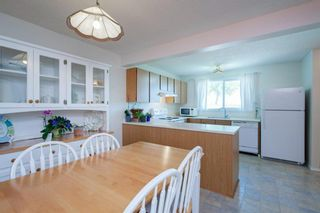 Photo 15: 332 Queenston Heights SE in Calgary: Queensland Row/Townhouse for sale : MLS®# A1114442