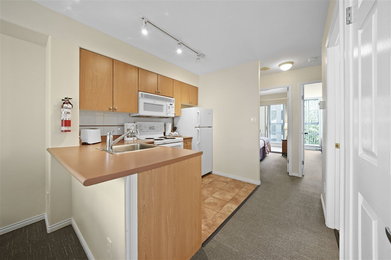 """Photo 8: Photos: 405 910 BEACH Avenue in Vancouver: Yaletown Condo for sale in """"MERIDIAN"""" (Vancouver West)  : MLS®# R2534010"""