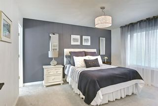 Photo 14: 75 Somerglen Place SW in Calgary: Somerset Detached for sale : MLS®# A1129654