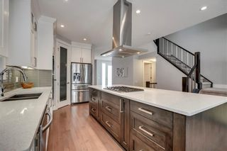 Photo 4: 1617 22 Avenue NW in Calgary: Capitol Hill Semi Detached for sale : MLS®# A1087502