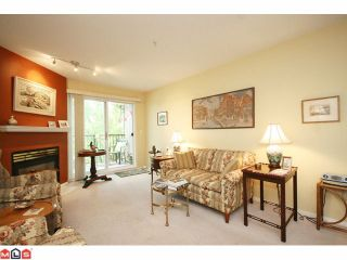 """Photo 2: 215 5765 GLOVER Road in Langley: Langley City Condo for sale in """"COLLEGE COURT"""" : MLS®# F1013966"""
