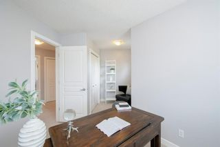 Photo 30: 32 Prominence Park SW in Calgary: Patterson Row/Townhouse for sale : MLS®# A1112438