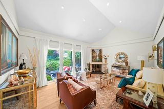 """Photo 2: 510 4001 MT SEYMOUR Parkway in North Vancouver: Roche Point Townhouse for sale in """"THE MAPLES"""" : MLS®# R2602101"""