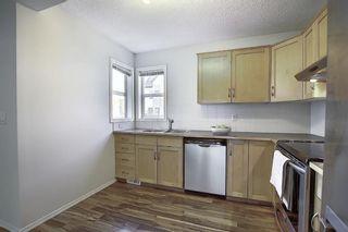 Photo 5: 25 200 HIDDEN HILLS Terrace in Calgary: Hidden Valley Row/Townhouse for sale : MLS®# A1022696