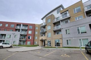 Photo 2: 2231 604 East Lake Boulevard NE: Airdrie Apartment for sale : MLS®# A1045955