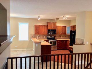 Photo 15: 708 Boulder Creek Drive SE: Langdon Detached for sale : MLS®# A1153144