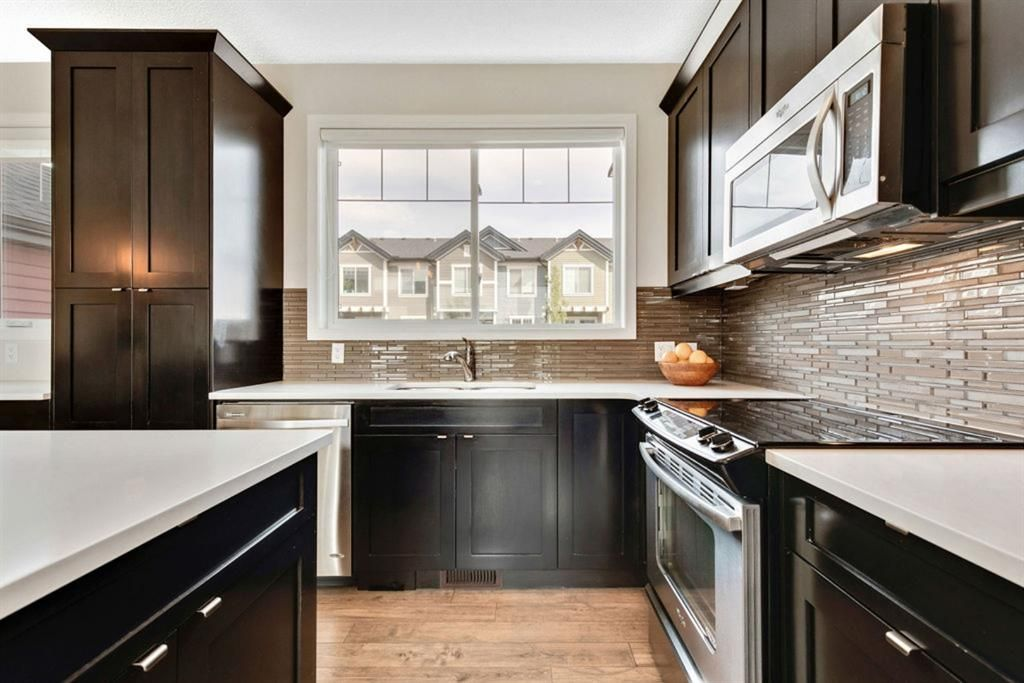 Main Photo: 8 NOLAN HILL Heights NW in Calgary: Nolan Hill Row/Townhouse for sale : MLS®# A1015765