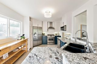Photo 10: 143 Capri Avenue NW in Calgary: Charleswood Detached for sale : MLS®# A1143044