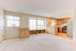 """Photo 4: 129 13888 70TH Avenue in Surrey: East Newton Townhouse for sale in """"Chelsea Gardens"""" : MLS®# R2594472"""