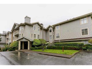 "Photo 1: 204 10721 139 Street in Surrey: Whalley Condo for sale in ""Vista Ridge"" (North Surrey)  : MLS®# F1439110"