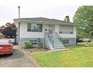Photo 2: 1402 COMO LAKE AV in Coquitlam: Central Coquitlam House for sale : MLS®# V536066