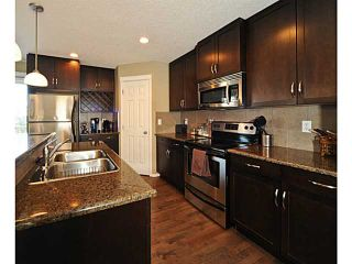 Photo 6: 14 COUNTRY VILLAGE Gate NE in CALGARY: Country Hills Village Townhouse for sale (Calgary)  : MLS®# C3578013