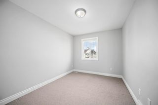 Photo 14: 5 Cougar Ridge Mews SW in Calgary: Cougar Ridge Row/Townhouse for sale : MLS®# A1105171