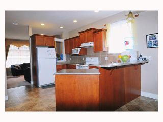 """Photo 4: 24315 101A Avenue in Maple Ridge: Albion House for sale in """"CASTLE BROOK"""" : MLS®# V792766"""