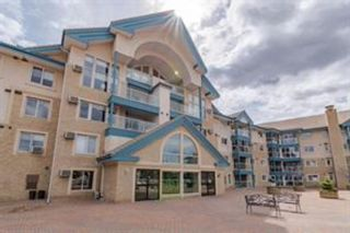 Main Photo: 218 7239 Sierra Morena Boulevard SW in Calgary: Signal Hill Apartment for sale : MLS®# A1102814