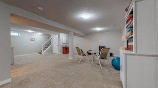 Photo 17: 210 Oakmoor Place SW in Calgary: Oakridge Detached for sale : MLS®# A1118445