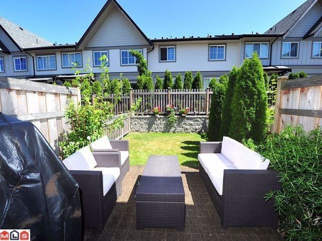 """Main Photo: 110 2501 161A Street in Surrey: Grandview Surrey Townhouse for sale in """"HIGHLAND"""" (South Surrey White Rock)  : MLS®# F1218591"""