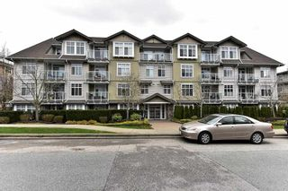 "Photo 1: 308 15323 17A Avenue in Surrey: King George Corridor Condo for sale in ""SEMIAHMOO PLACE"" (South Surrey White Rock)  : MLS®# R2148020"