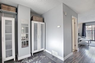 Photo 3: 104 7172 Coach Hill Road SW in Calgary: Coach Hill Row/Townhouse for sale : MLS®# A1097069