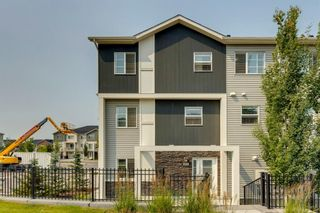 Photo 1: 912 Redstone View NE in Calgary: Redstone Row/Townhouse for sale : MLS®# A1136349
