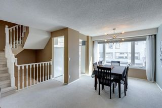 Photo 6: 81 Coachway Gardens SW in Calgary: Coach Hill Row/Townhouse for sale : MLS®# A1147900