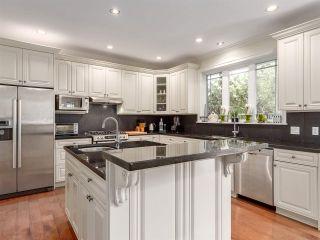 "Photo 1: 1012 CONDOR Place in Squamish: Garibaldi Highlands House for sale in ""Thunderbird Creek"" : MLS®# R2203842"