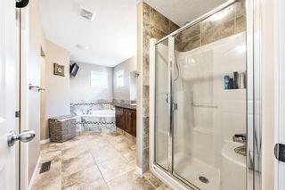 Photo 15: 494 Boulder Creek Way SE: Langdon Semi Detached for sale : MLS®# A1148702