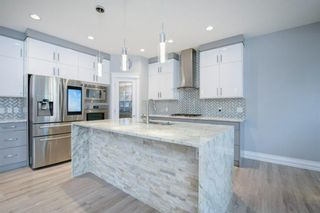 Photo 11: 48 Tremblant Terrace SW in Calgary: Springbank Hill Detached for sale : MLS®# A1131887