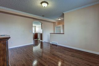 Photo 5: 64 Eversyde Circle SW in Calgary: Evergreen Detached for sale : MLS®# A1090737