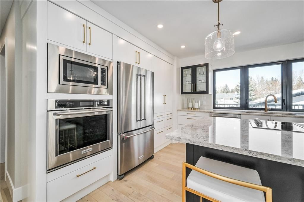 Photo 7: Photos: 5039 BULYEA Road NW in Calgary: Brentwood Detached for sale : MLS®# A1047047