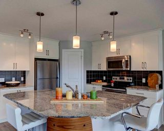 Photo 4: 171 AUBURN MEADOWS Place SE in Calgary: Auburn Bay House for sale : MLS®# C4119383