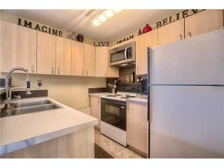 Photo 4: 869 QUEENSLAND Drive SE in CALGARY: Queensland Residential Attached for sale (Calgary)  : MLS®# C3616074