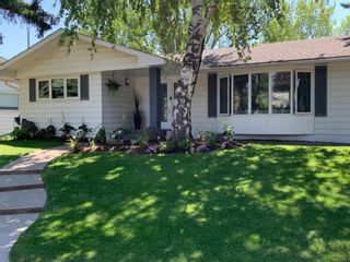 Photo 1: 419 Woodbend Road SE in Calgary: Willow Park Detached for sale : MLS®# A1075993