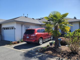 Photo 1: 16 6595 Groveland Dr in : Na North Nanaimo Row/Townhouse for sale (Nanaimo)  : MLS®# 873596