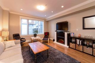 """Photo 2: 310 SEYMOUR RIVER Place in North Vancouver: Seymour NV Townhouse for sale in """"The Latitudes"""" : MLS®# R2333638"""