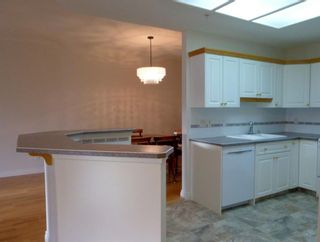 Photo 5: 107 200 Patina Court SW in Calgary: Patterson Apartment for sale : MLS®# A1067548