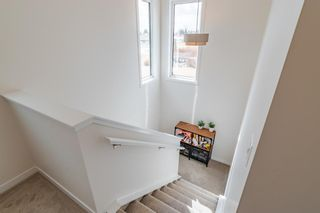 Photo 21: 145 Shawnee Common SW in Calgary: Shawnee Slopes Row/Townhouse for sale : MLS®# A1097036