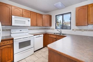 Photo 10: 452 Woodside Road SW in Calgary: Woodlands Detached for sale : MLS®# A1147030
