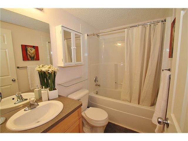 Photo 17: Photos: 4210 70 PANAMOUNT Drive NW in Calgary: Panorama Hills Condo for sale : MLS®# C4076260