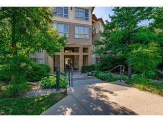 """Photo 1: 212 15918 26 Avenue in Surrey: Grandview Surrey Condo for sale in """"THE MORGAN"""" (South Surrey White Rock)  : MLS®# R2364588"""